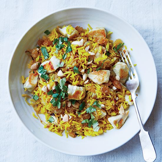 Chicken Rice Pilaf | Get the recipe for this delicious one-dish, spiced-up chicken and rice at Food & Wine.