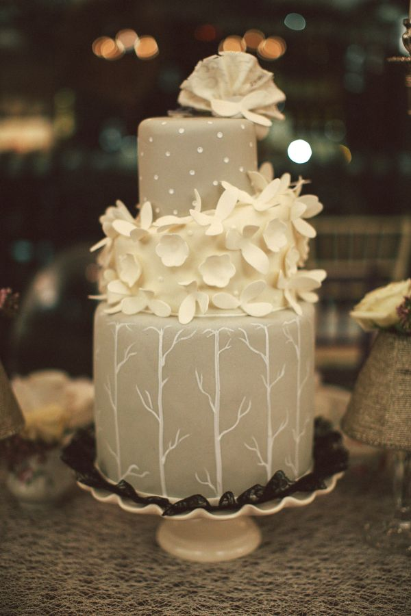 gray and white wedding cake- love this but without the flowers around the middle.