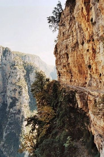 The ten-mile-long Vikos Gorge in Epirus Greece, one of Europe's largest, is tough to tackle on foot, but the Balkoni tou Vikou (Vikos' Balcony), is an ideal vantage point from above. http://www.360cities.net/image/vikos-gorge-oksia-location-end-of-trail-greece