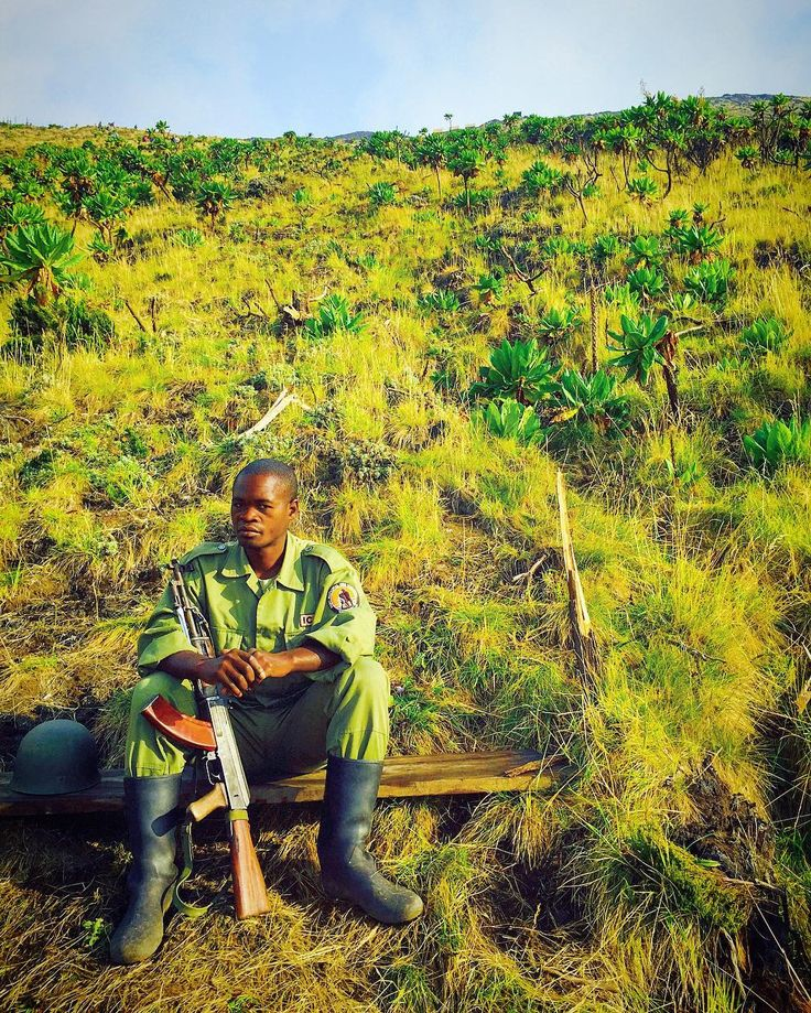 Capturing a candid portrait of a Congolese soldier resting after a long hike. In order to climb Mount Nyiragongo, the DRC government requires that travelers are escorted. The ascent is challenging, but the lava filled crater at the top is one of the more amazing sights on the planet #DRC #Africa | Photo by @socialnomads
