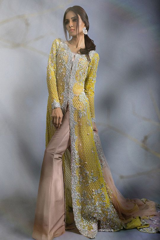Sana Safinaz Diffusion Couture collection beautifully epitomizes class, elegance and opulence. The model posing against a misty and earthy back drop oozes a mysterious and enigmatic vibe. An elegan…