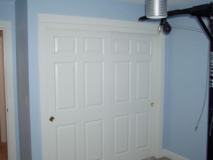 white pine wood sliding closet doors combined light blue painted wall as well as new closet