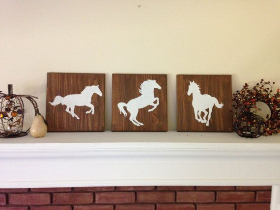 This simple set of silhouettes would be a wonderful gift for any horse lover. The dark stained wood makes a lovely addition to any rustic decor scheme. Hand-painted in cream on base of walnut-stained wood. Protected with a clear topcoat. Measure approximately 12 x 12 each. Designed to either hang easily on a single nail or to lean on a shelf or mantel.  Our silhouettes are inspired by animals commonly seen around country homes, and we can customize your order with the animal of your choice…