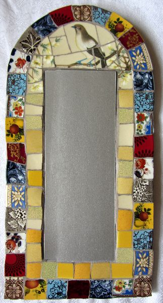 mosaic mirror.  Perhaps using blue and white plates with large design at top?