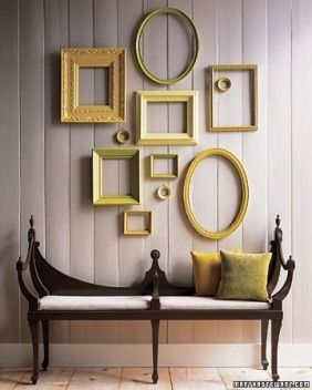 love these antique frames. paint them all the same color and it becomes cohesive!