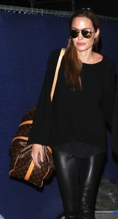 "Angelina Jolie travels with a Louis Vuitton ""Keepall 45"" luggage"
