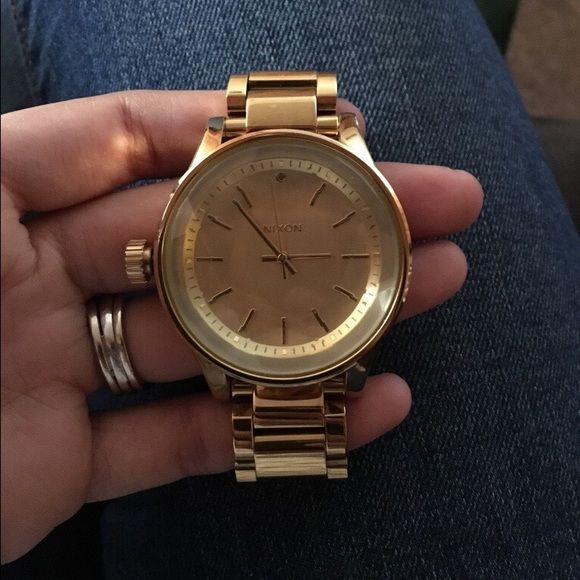 Like New Nixon Women's Watch All gold color. Retails for $250. I wore it for about a month tops. Faceted watch face. Double clasp that functions the way it should. Gorgeous condition. Comes with links taken out at time of sizing, and extra links for versatility sizing of the buyer. Battery runs perfect. The face is big, and the watch has a good weight to it. I will state again that this is a women's watch. Box is not included. Nixon Accessories Watches