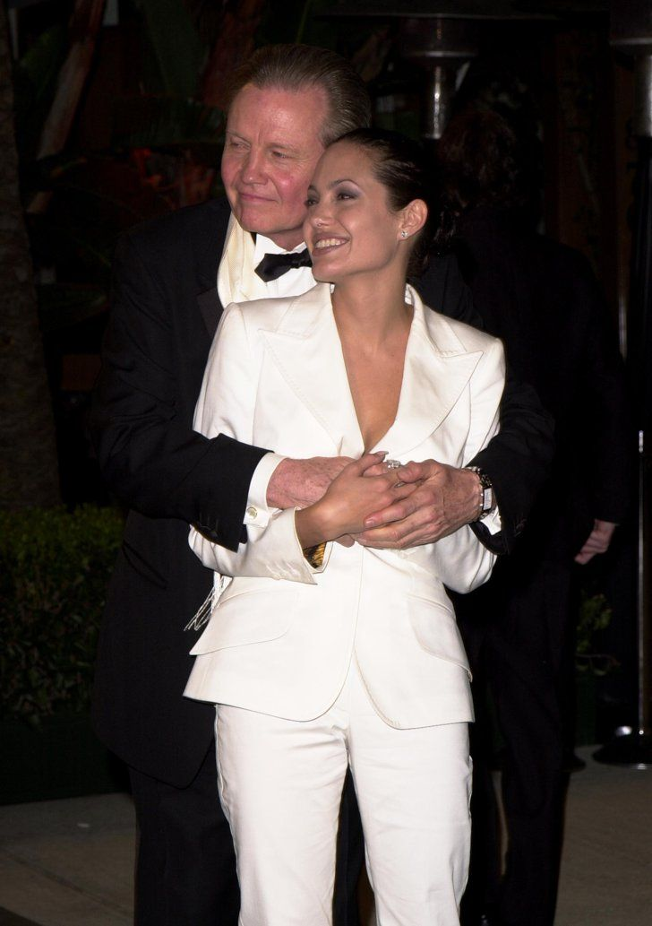 Pin for Later: 50+ Stars With Their Dear Old Dads Angelina Jolie Angelina got a hug from her actor father, Jon Voight, at the Vanity Fair post-Oscars bash in February 2001.