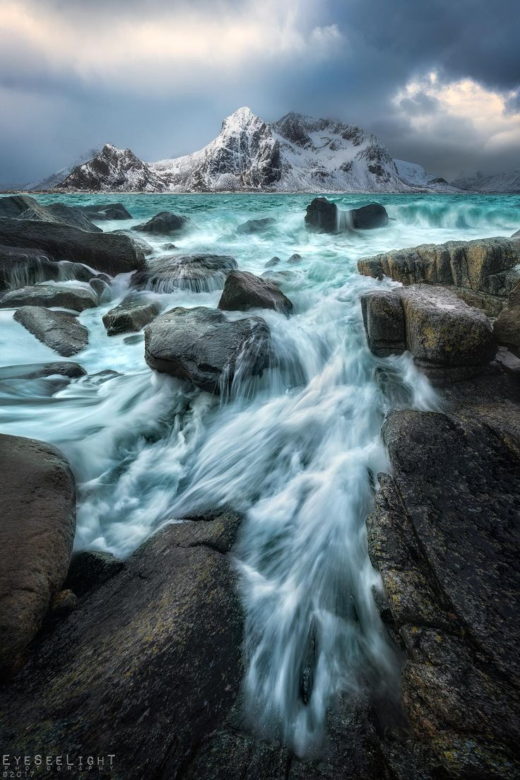Icy cold arctic waves crashing right in front of me Lofotens gloomy blue waters were reaching out  Flakstadøya Norway  [OC] [1920x1280]