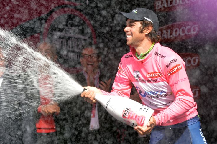 Cyclist Michael Matthews celebrates another day in the pink jersey.