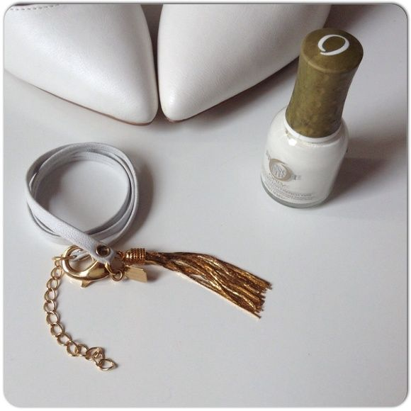 NEW WHITE LEATHER TRIPLE WRAP BRACELET 18K GPHW New white hand made leather triple wrap bracelet with large lobster clasp closure & gold hanging tassel plated in 18K gold. The tassel hangs beautifully from the wrist & definitely is a statement piece. Single chain adjuster to allow for added length. I like this mixed up with a couple of print or darker leather to show contrast. Made in NYC. The craftwomanship is amazing in this artisans pieces. Makers hang tag is on the design! Jewelry…