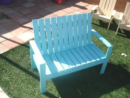 Kids bench.  Would be cute outside the playhouse.