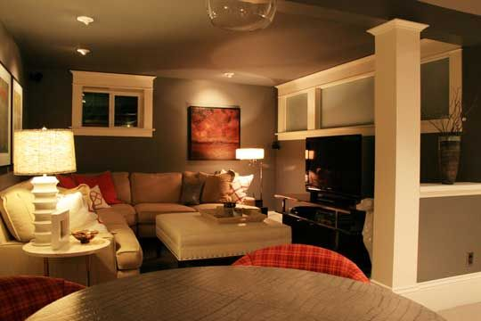 basement rec. room. I like the window molding. This also shows that darker wall colors can look nice in a basement.