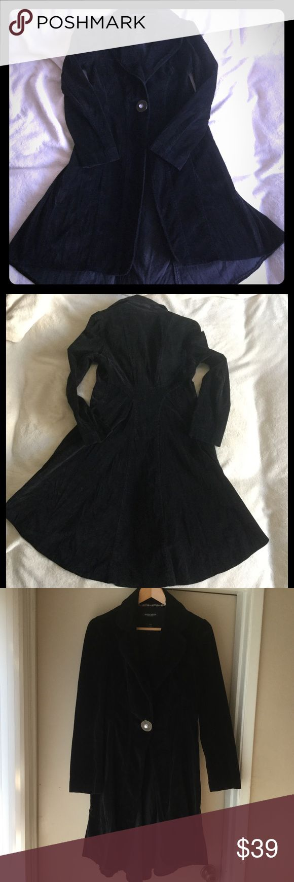 Bisou Bisou coat Worn a couple of times, black coat, stretch fabric. Longer in the back, very flattering. I love it but it's too small for me. Snaps in the front. Great with a dress, jeans or anything else. The size fit says medium, but fits more like 4-6, so smaller medium. I wore this at 135 lbs, I am 5'7. Bisou Bisou Jackets & Coats