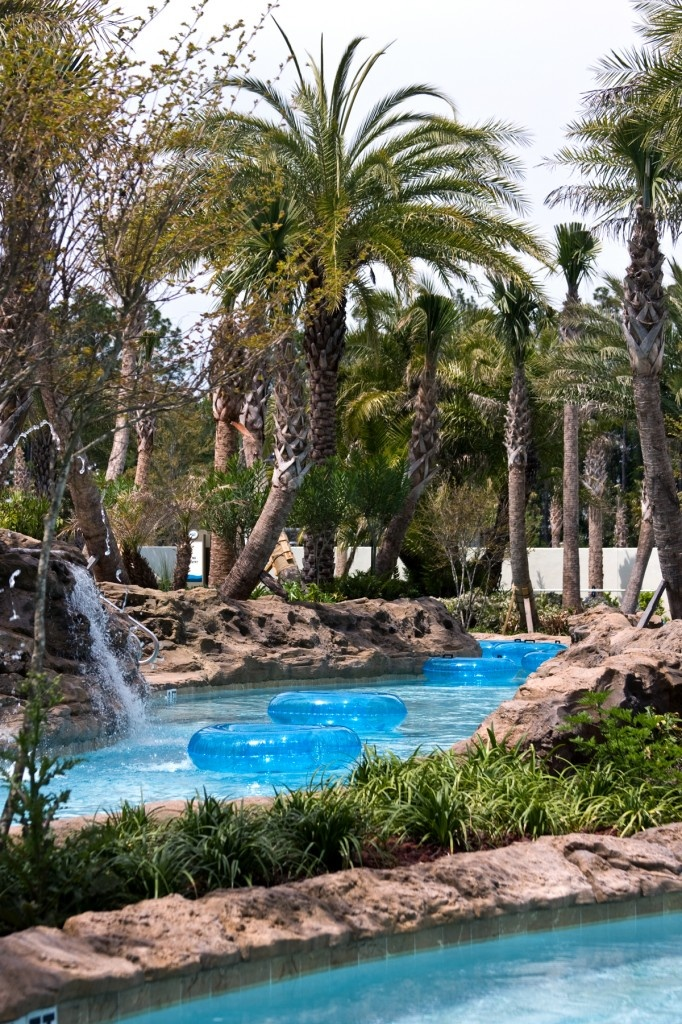An outdoor lazy river is never complete without a for Beautiful swimming pools with waterfalls