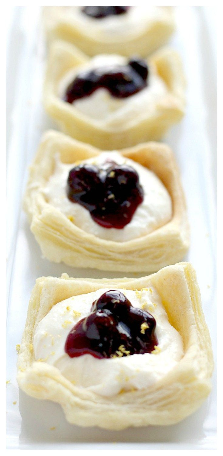 This is a very easy recipe for a beautiful, delicious dessert! Creamy No-Bake Lemon Cheesecake fills puff pastry cups and is topped with a lightly sweet blueberry sauce! It's the perfect summer recipe for entertaining, or just enjoy these pastries whenever you want!