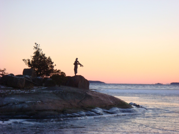 Sunset and a statue
