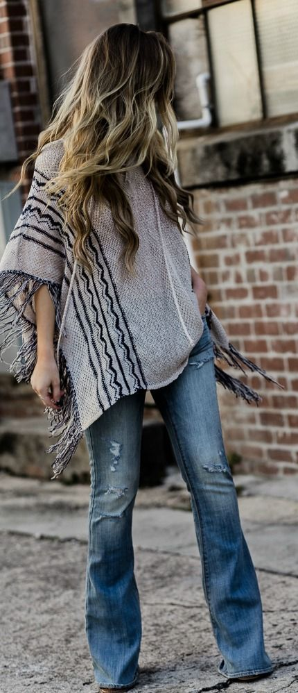 5cbae44e9ef04c How to style flared jeans with fringe poncho for a casual boho outfit  #BohoFashion