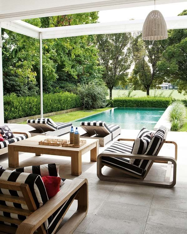 At Home: Summer Swing. Wide stripes and lush greenery by a pool in Montauk. I could lounge here! @Move LifeStyle