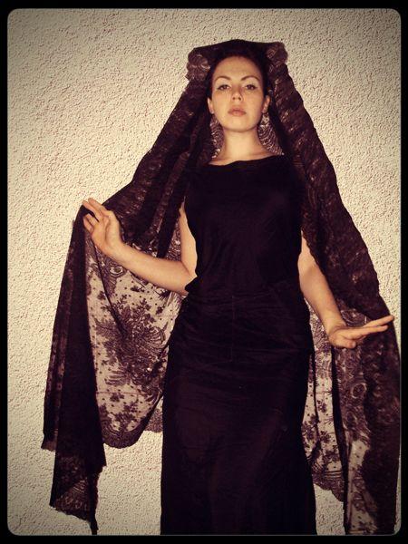One way to wear a triangular Chantilly shawl. It isn't strictly a mantilla, but looks impressive.