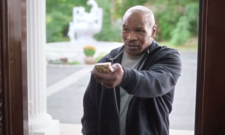 Mike Tyson 'returns Evander Holyfield's ear' in Foot Locker commercial