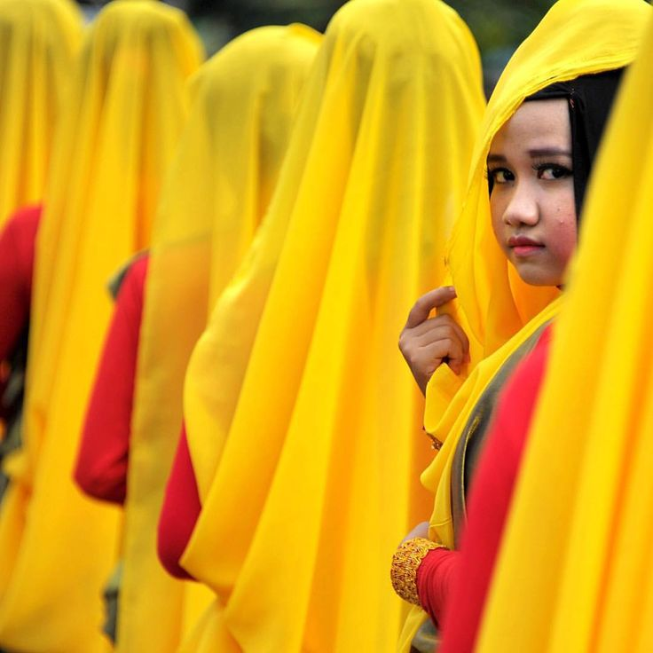 #Acehnese women wearing #colorful #costumes take part in the celebrations of the #Islamic New Year in Banda Aceh, capital of Indonesia's conservative Islamic province of #Aceh, on the #Sumatra Island on October 14. #colour #yellow #beautiful #thetimes Picture: MAHYUDDIN/AFP/Getty Images
