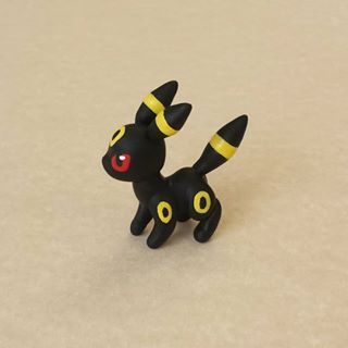 Umbreon! This Pokémon was made from polymer clay. Details were painted with…