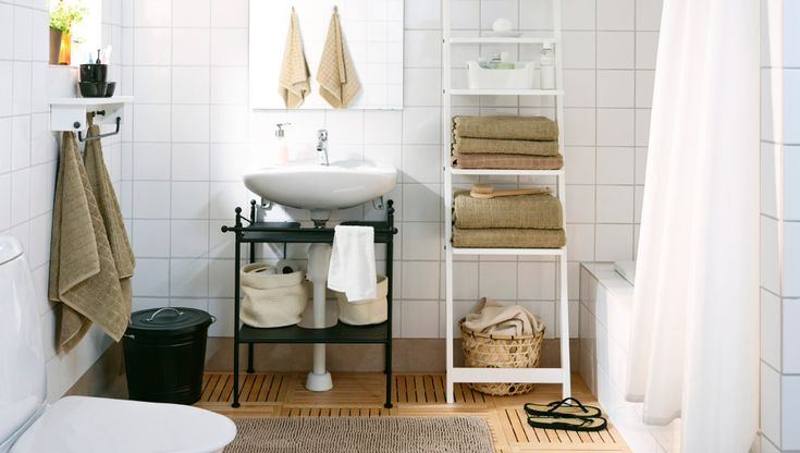 Don't renovate – refresh your bathroom! We gave this bathroom a complete makeover by making just a few easy changes, like an IKEA sink shelf for under the sink and a couple of tall IKEA shelves for more storage space.