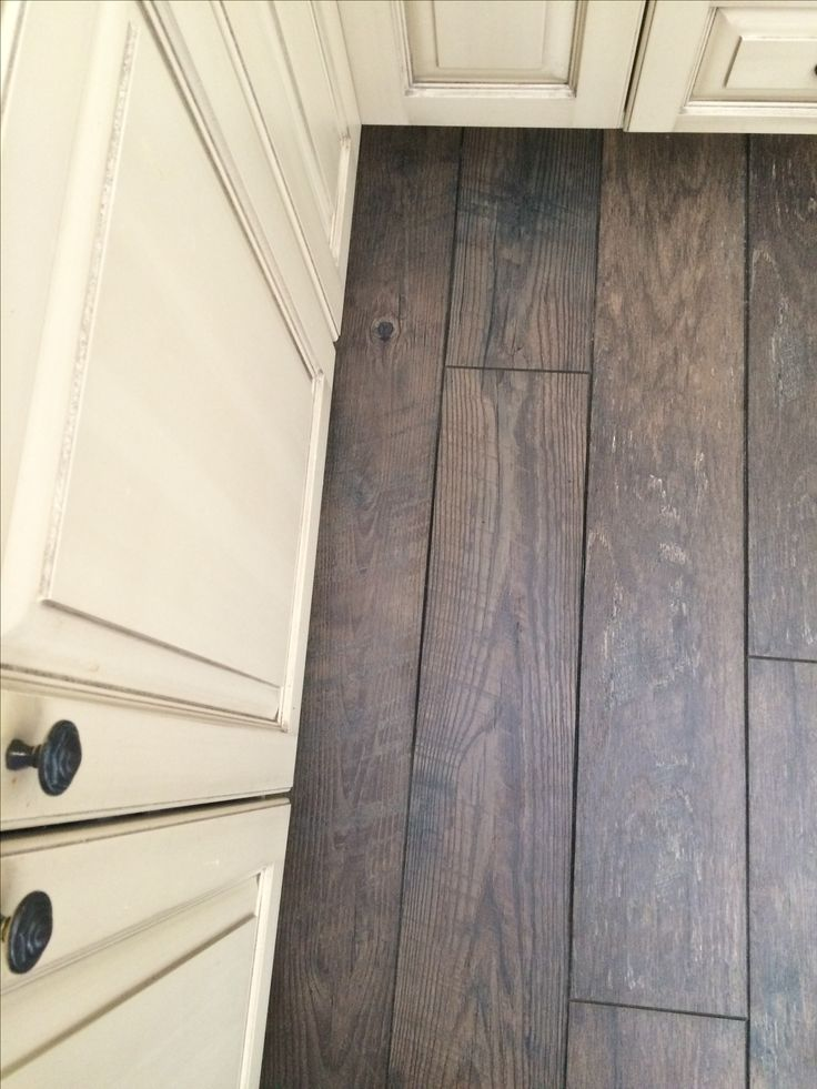 Mannington Historic Oak in Charcoal with Buttercream cupboards...very happy with our choice.