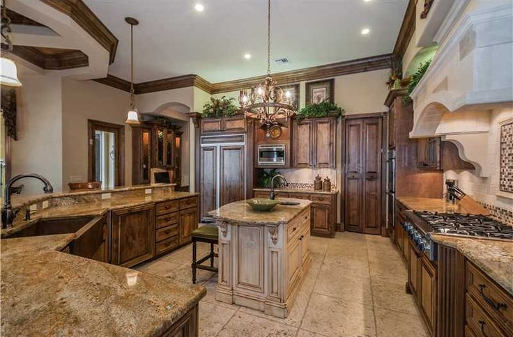 Mediterranean Kitchen with Crown molding, Stone Tile, U-shaped, Kitchen island, High ceiling, Farmhouse sink, Breakfast bar