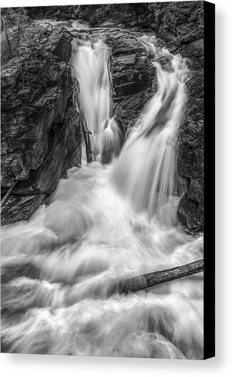 This image was taken in Glacier National Park. The use of black and white helps to portray a dramatic interpretation on the scene. Also, the long exposure of the water conveys a sense of strength. #photography #waterfall #homedecor