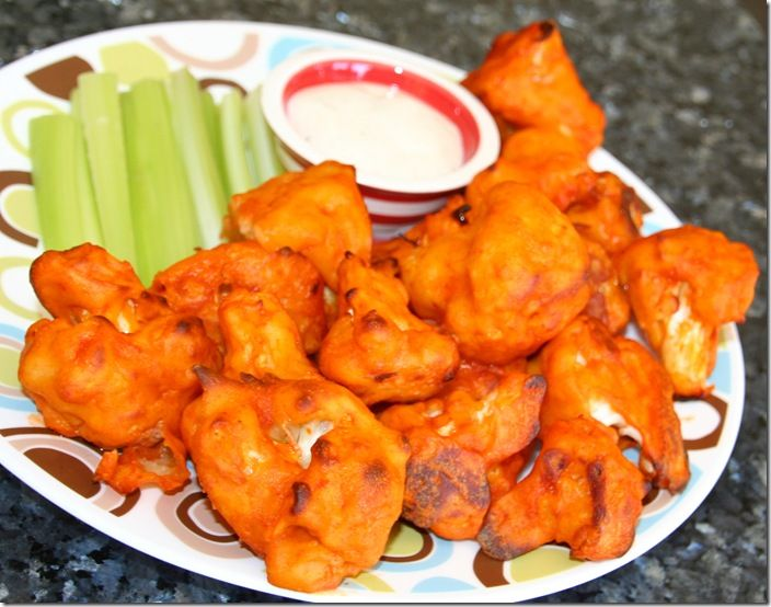 Buffalo Cauliflower 1 head cauliflower,  cut into pieces 4 TBS. buttermilk powder mixed 1 cup water 1 cup all-purpose flour  1 1/2 tsp. garlic powder 1/2 tsp. sea salt  1 cup Franks Red Hot Sauce   1 TBS, butter, melted Blue cheese or ranch dressing and celery for serving
