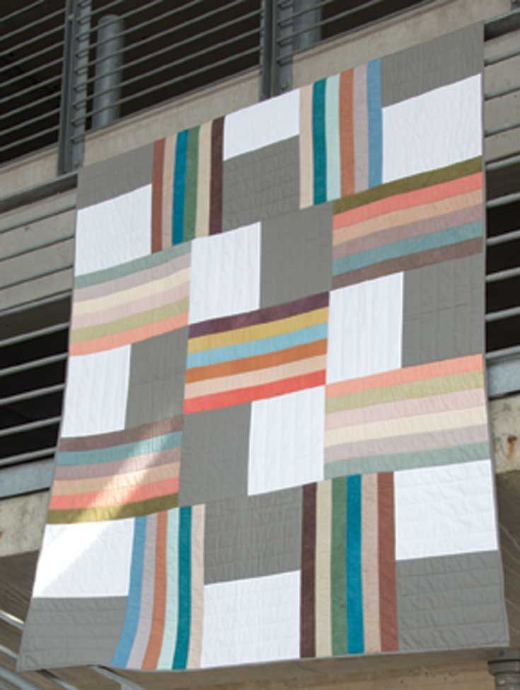 Easy-Cut Quilts with a Modern Twist by Laurel Albright | Landauer Publishing This quilt would be so easy to cut with an #accuquilt strip cutter!