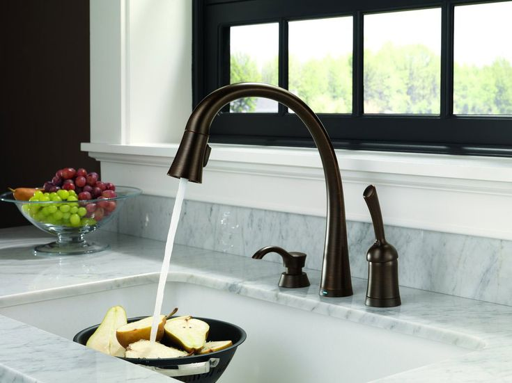 amazing Fancy Kitchen Faucets #4: Fancy Goose Neck Brushed Kitchen Faucet Come With White Marble Countertop  And Contemporary Clear Glass Bowl And Brown Wooden Stained Window.