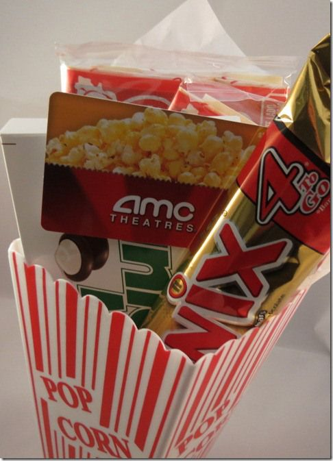 movie gift card with treats in popcorn bin. Site has lots of cute gift card presentation ideas...