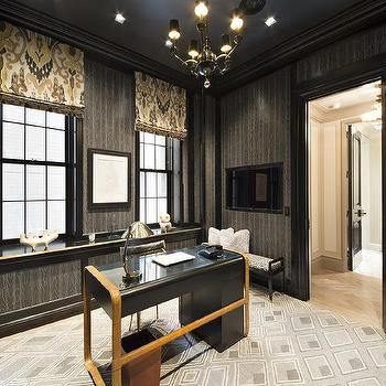 Contemporary study features a dark gray ceiling accented with a black and gold chandelier over walls clad in gray faux bois wallpaper fitted with a
