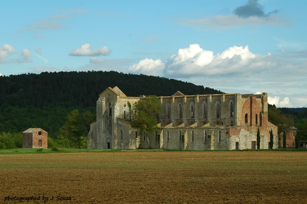 The abandoned abbey of San Galgano in Tuscany is beautiful.  An added bonus is that you might have the whole place to yourself.
