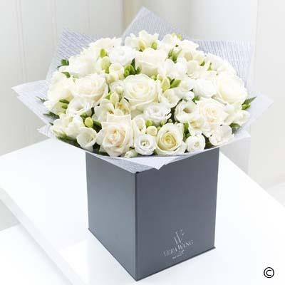 The image of purity, perfection and grace, this Vera Wang bouquet is created from the very finest flowers. The subtle difference in tone, from warm cream to snow white, gives depth and texture, and the delicate double freesias provide a sweet fragrance which only adds to the enjoyment of this picture-perfect gift.