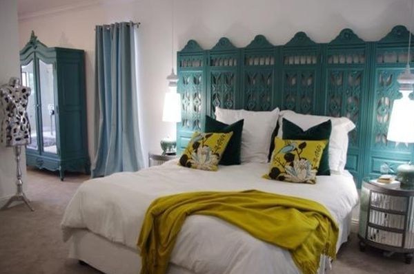 oom divider. It's an ingenious use of that piece and, when you think about, it makes sense. Also, the color of the headboard matches the furniture and the curtains so it integrates beautifully into the whole décor-turquoise