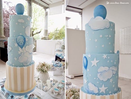 The huge cake for this monogram balloon themed baptism party