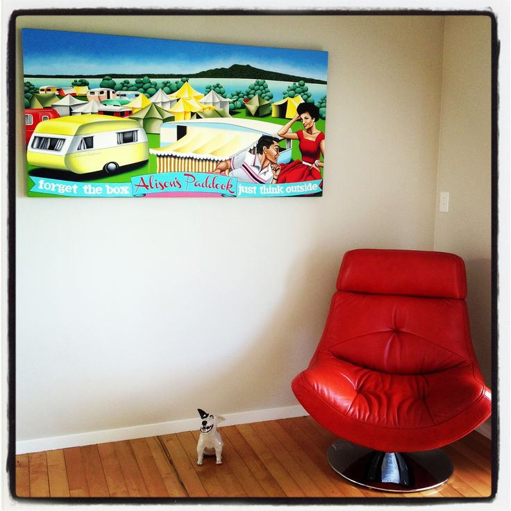 My painting hanging at it's new owner's home.  Takapuna Camping Ground 'Alison's Paddock' captured back in the 1950's.  Auckland. New Zealand. Looks great with the bright red leather chair!  ... Prints are available online.