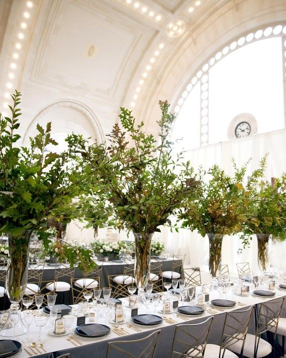 Centerpieces Alternated Between Low, Conversation Friendly Cinder Block  Containers Of Flowers And Tall