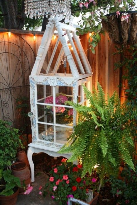 (~TA patio conservatory made from old windows - very cute, love these legs on it, would prefer different spindles at the top, love a glass doorknob, so pretty!)