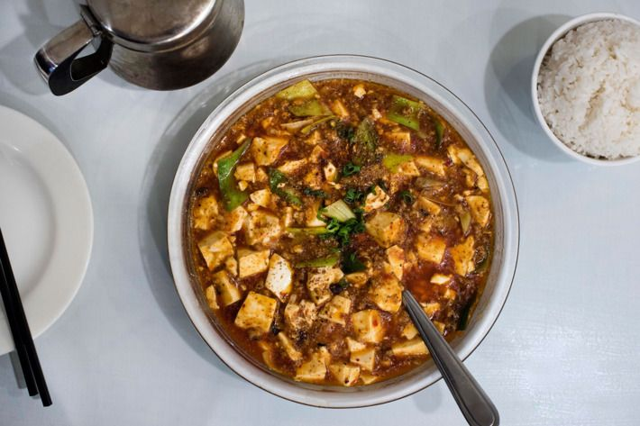 """mapo tofu chili oil thick with cubes of silky tofu ground pork or beef & fermented black-bean paste or doubanjiang (broad-bean-chile paste) or both & mala numbing spiciness combo of ground Sichuan pepper & chili peppers. Most versions also include trapezoids of bright-green sautéed leeks, and sometimes snips of scallion. And there's even an intriguing origin story. """"Mapo"""" can be translated to mean """"crater-f"""