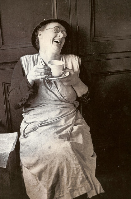 A bedmaker enjoys a cup of #tea at Cambridge University, England, 1939