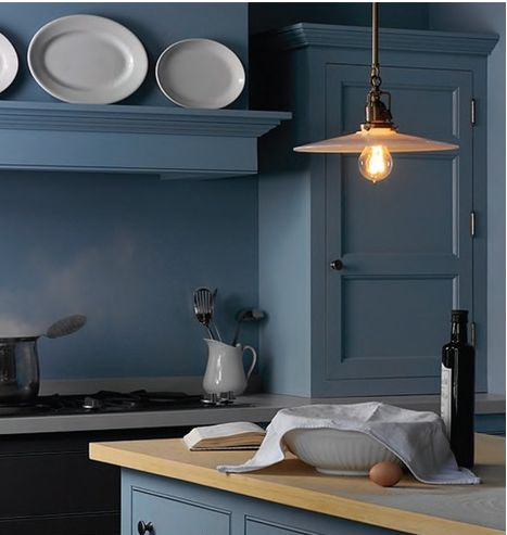 Beautiful bespoke kitchen (what's that?)   anyway, a lovely color and so very simple in its lines.