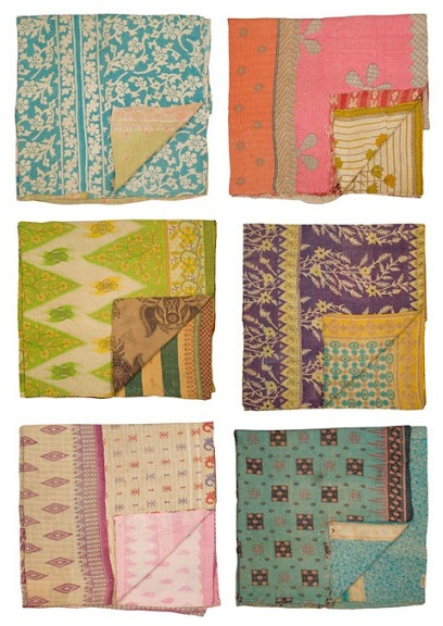 kantha stitched quilts. blankets of indian sari's sewn together.