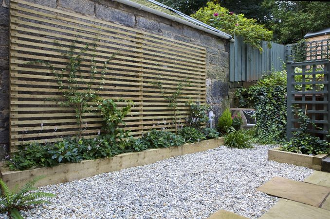 [East fence and move the river rocks or rocks from under the sumac?] Revive a dark & damp part of a garden