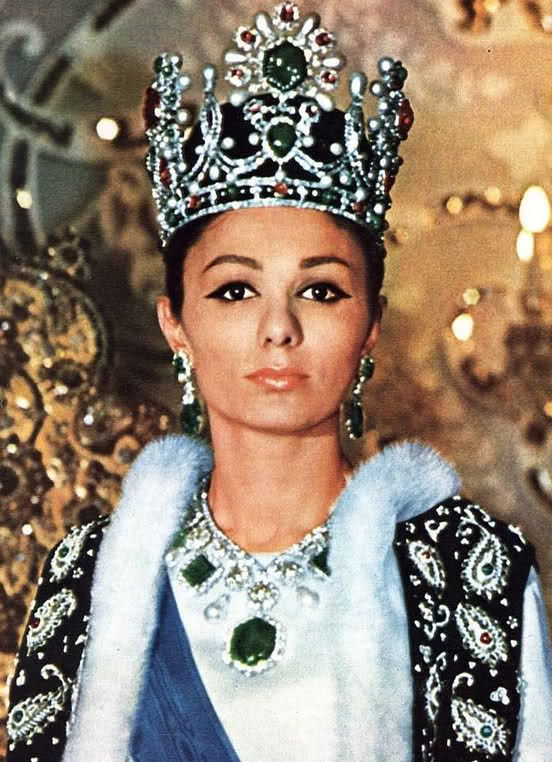 Farah Diba Crowned Empress of Iran 1967 - Farah Diba was the first wife of a Persian Monarch to be crowned so an imperial crown was commissioned for her coronation at Tehran. The gems came from the Iranian Treasury and Van Cleef and Arpels designed and made the crown. The gems include a 91ct emerald, pearls, rubies, spinels and almost 1500 diamonds, all set in a white gold frame. Van Cleef and Arpels also designed the impressive gold and platinum necklace from which hang one very large…