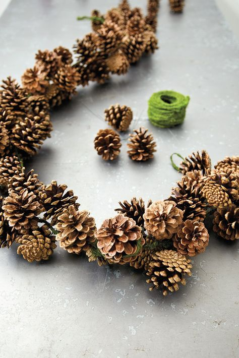 Rustic Pinecone Garland - a length of jute is used as the main garland, with pinecones wired to the jute with paper-covered wire - via How To Decorate